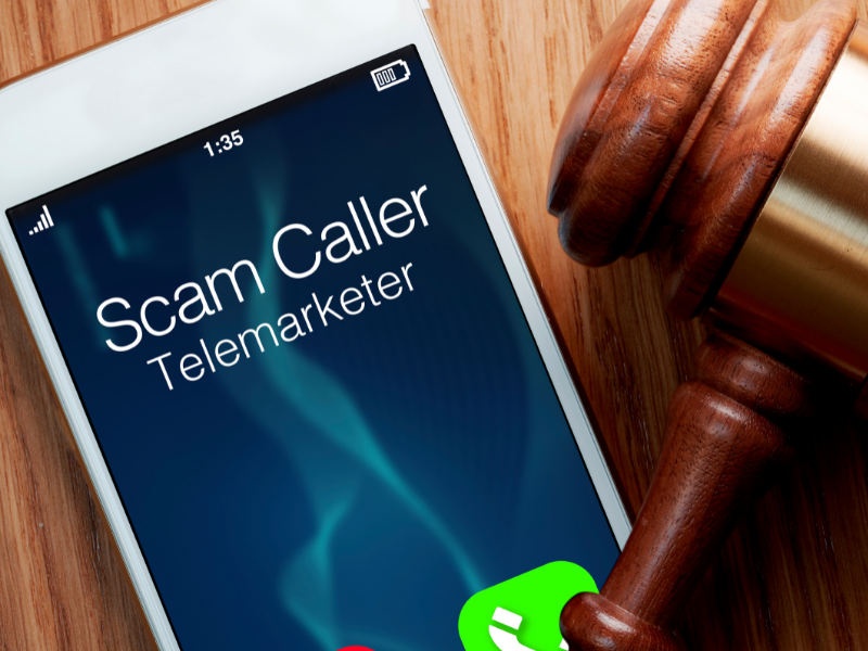 how to stop robocalls - cellphone with Scam Caller Telemarketer on caller ID